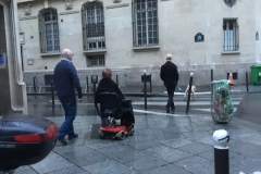navigating streets of paris in a wheelchair. photo by kerry williams