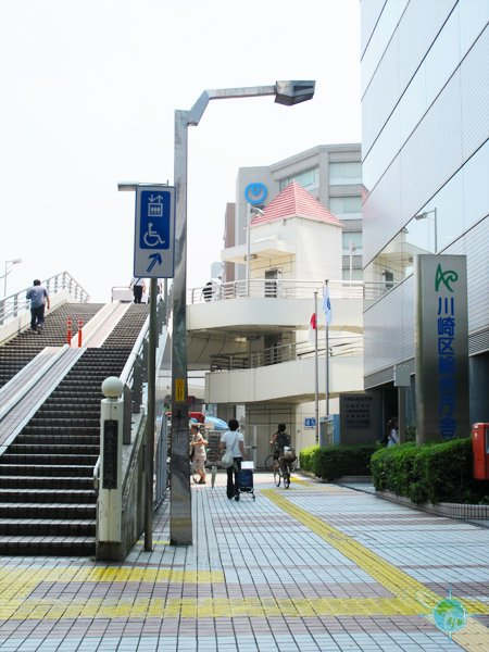 Sign to Elevator to Elevated Walkway